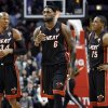 Miami Heat forward LeBron James, center, and guard Mario Chalmers, right, listen to guard Ray Allen during the second half of an NBA basketball game against the Chicago Bulls in Chicago on Wednesday, March 27, 2013. The Bulls won 101-97, ending the Heat\'s 27-game winning streak. (AP Photo/Nam Y. Huh)