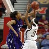 Aggie Takia Starks shoots over the block of Jalana Childs during the 2009 Big 12 Women\'s Basketball Championship game between Kansas State Wildcats and the Texas A&M Aggies in the Cox Convention Center in Oklahoma City, Oklahoma, on Friday, March 13, 2009. PHOTO BY STEVE SISNEY, THE OKLAHOMAN