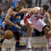Photo - Toronto Raptors guard Jose Calderon, right, and Oklahoma City Thunder guard Russell Westbrook battle for a loose ball during first-half NBA basketball game action in Toronto, Sunday, Jan.6, 2013. (AP Photo/The Canadian Press, Frank Gunn) ORG XMIT: FNG103