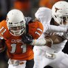 Zac Robinson stiff arms a defender in OSU\'s 41-14 loss to Texas. Photo by Sarah Phipps, The Oklahoman