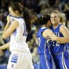 Lomega\'s Ashley LaGasse (22), right, and Kylie Turner (10) hug as Hammon\'s Kala Morris (10) leaves the court after a Class B Girls semifinal game of the state high school basketball tournament between Hammon and Lomega at Jim Norick Arena, The Big House, on State Fair Park in Oklahoma City, Friday, March 1, 2013. Lomega won, 60-52. Photo by Nate Billings, The Oklahoman