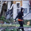 Amy McQueen, 28 rushes to her brother\'s house Monday, Feb. 11, 2013 to help him remove the his belongings after is was destroyed by Sunday\'s tornado in Hattiesburg, Miss. (AP Photo/Rogelio V. Solis)