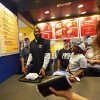 James Harden of the Oklahoma City Thunder brings food to a customer at the new Raising Cane\'s in Edmond, Thursday, September 27, 2012. Photo by Bryan Terry, The Oklahoman
