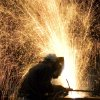 FILE - In this Oct. 9, 2007 file photo, an ironworker in Lynchburg, Va. welds steel destined for New York\'s One World Trade Center building. (AP Photo/Mark Lennihan, File)