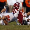 Oklahoma State\'s Clint Chelf (10) is sacked by Oklahoma\'s Aaron Colvin (14) during the second half of the Bedlam college football game in which the University of Oklahoma Sooners (OU) defeated the Oklahoma State University Cowboys (OSU) 51-48 in overtime at Gaylord Family-Oklahoma Memorial Stadium in Norman, Okla., Saturday, Nov. 24, 2012. Photo by Steve Sisney, The Oklahoman