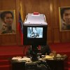 Backdropped by portraits of independence hero Simon Bolivar, a TV camera transmits live a press conference by Venezuela\'s President Hugo Chavez at the Miraflores palace in Caracas, Venezuela, Tuesday, Oct. 9, 2012. The 58-year-old former military officer Chavez won his fourth consecutive presidential bid Sunday and shows no signs of ballot fatigue. (AP Photo/Rodrigo Abd)