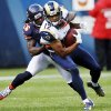 Photo -   St. Louis Rams wide receiver Steve Smith (12) is tackled from behind by Chicago Bears cornerback Tim Jennings (26) in the first half of an NFL football game in Chicago, Sunday, Sept. 23, 2012. (AP Photo/Charles Rex Arbogast)