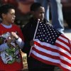 Boys from Soldier Creek Elementary School stand along Douglas Blvd. to watch the parade as it passes in front of their school. The city of Midwest City teamed with civic leaders and local merchants to display their appreciation for veterans and active military forces by staging a hour-long Veteran\'s Day parade that stretched more than a mile and a half along three of the city\'s busiest streets Monday morning, Nov. 12, 2012. Hundreds of people lined the parade route, many of them waving small American flags that had ben distributed by volunteers who marched near the front of the parade. A fly-over performed by F-16s from the138th Fighter Wing, Oklahoma Air National Guard unit in Tulsa thrilled spectators. Five veterans representing military personnel who served in five wars and military actions served as Grand Marshals for the parade. Leading the parade was the Naval Reserve seven-story American flag, carried by 100 volunteers from First National Bank of Midwest City, Advantage Bank and the Tinker Federal Credit Union. The flag is 50 feet by 76 feet, weighs 110 pounds and was sponsored by the MWC Chapter of Disabled American Veterans. Photo by Jim Beckel, The Oklahoman