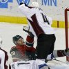 Colorado Avalanche\'s Greg Zanon, right, sends Minnesota Wild\'s Nate Prosser toppling over Avalanche goalie Semyon Varlamov of Russia, bottom, in the first period of an NHL hockey game Saturday, Jan. 19, 2013 in St. Paul, Minn. (AP Photo/Jim Mone)