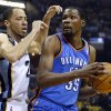 Oklahoma City\'s Kevin Durant (35) looks to the basket as Memphis\' Tayshaun Prince (21) defends during Game 6 in the first round of the NBA playoffs between the Oklahoma City Thunder and the Memphis Grizzlies at FedExForum in Memphis, Tenn., Thursday, May 1, 2014. Photo by Bryan Terry, The Oklahoman