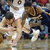 Atlanta Hawks guard Kyle Korver, left, and Indiana Pacers forward Paul George (24) vie for a loose ball during the second half of an NBA basketball game on Saturday, Dec. 29, 2012, at Philips Arena in Atlanta. Atlanta won 109-100. (AP Photo/John Amis)