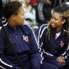 Langston women\'s basketball players Alex Adekunle (left) and Kashyla Fields (right) look at each other in surprise after new head coach Cheryl Miller describes their summer training program at a press conference in Langston on Tuesday, April 29, 2014 Photo by KT King, The Oklahoman