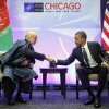 President Barack Obama, right, shakes hands with with Afghan President Hamid Karzai, left, during their meeting at the NATO Summit in Chicago, Sunday, May 20, 2012. With Obama, Karzai thanked Americans for the help their \'taxpayer money\' has done in Afghanistan. (AP Photo/Pablo Martinez Monsivais)