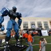 People walk by the Fox robot before a college football game between the Oklahoma State University Cowboys (OSU) and the University of Kansas Jayhawks (KU) at Boone Pickens Stadium in Stillwater, Okla., Saturday, Nov. 9, 2013. Photo by Sarah Phipps, The Oklahoman