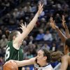 Photo - Connecticut's Breanna Stewart, center, passes around South Florida's Katelyn Weber (45) during the first half of an NCAA college basketball game in Hartford, Conn., Sunday, Jan. 26, 2014. (AP Photo/Fred Beckham)