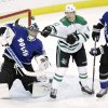 Photo - Dallas Stars right wing Alex Chiasson (12) reaches out to deflect the puck in front of Tampa Bay Lightning goalie Ben Bishop (30) and defenseman Eric Brewer (2) during the first period of an NHL hockey game on Saturday, April 5, 2014, in Tampa, Fla. (AP Photo/Chris O'Meara)