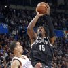 Brooklyn Nets\' Gerald Wallace (45) drives past Oklahoma City\'s Kevin Martin (23) during the NBA basketball game between the Oklahoma City Thunder and the Brooklyn Nets at the Chesapeake Energy Arena on Wednesday, Jan. 2, 2013, in Oklahoma City, Okla. Photo by Chris Landsberger, The Oklahoman