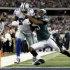 Photo - Dallas Cowboys wide receiver Dez Bryant (88) scores a touchdown as Philadelphia Eagles cornerback Dominique Rodgers-Cromartie (23) defends during the second half of an NFL football game, Sunday, Dec. 2, 2012, in Arlington, Texas. (AP Photo/Tony Gutierrez)