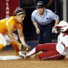OU\'s Destinee Martinez (00) slides into third base to triple as Tennessee\'s Raven Chavanne (88) tries to make the tag in the eleventh inning during Game 1 of the Women\'s College World Series NCAA softball championship series between Oklahoma and Tennessee at ASA Hall of Fame Stadium in Oklahoma City, Monday, June 3, 2013. OU won 5-3 in 12 innings. Photo by Nate Billings, The Oklahoman