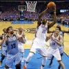 Oklahoma City\'s Kevin Durant (35) shoots between Steven Adams (12) and Memphis\' Marc Gasol (33) during Game 7 in the first round of the NBA playoffs between the Oklahoma City Thunder and the Memphis Grizzlies at Chesapeake Energy Arena in Oklahoma City, Saturday, May 3, 2014. The Thunder won 120-109. Photo by Nate Billings, The Oklahoman