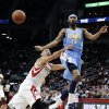 Denver Nuggets\' Corey Brewer (13) passes off the ball under pressure from Houston Rockets\' Jeremy Lin (7) in the first half of an NBA basketball game Wednesday, Jan. 23, 2013, in Houston. (AP Photo/Pat Sullivan)