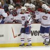 Photo - Montreal Canadiens' Daniel Briere (48) is greeted by teammates on the bench after scoring in the second period of an NHL hockey game against the Pittsburgh Penguins, Thursday, Feb. 27, 2014 in Pittsburgh. (AP Photo/Keith Srakocic)