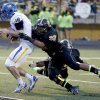 Stillwater\'s Braxton Noble gets by Midwest City\'s Camron Carson as he scores a touchdown during the high school football game between Midwest City and Stillwater at Midwest City, Okla., Friday, Sept. 13, 2013. Photo by Sarah Phipps, The Oklahoman