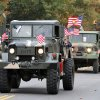 Military vehicles drive down Jenkins Avenue during the Veterans Day parade in Norman Sunday. PHOTO BY HUGH SCOTT FOR THE OKLAHOMAN ORG XMIT: KOD