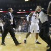 Oklahoma City coach Scott Brooks runs onto the court towards official Ed Malloy and Memphis\' James Johnson (3) during Game 6 in the first round of the NBA playoffs between the Oklahoma City Thunder and the Memphis Grizzlies at FedExForum in Memphis, Tenn., Thursday, May 1, 2014. Oklahoma City won 104-84. Photo by Bryan Terry, The Oklahoman