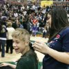 Ethan Freeman has his head shaved by fellow student Kasey Cohlmia during an assembly raising money for Special Care, during Double Wolf Dare Week in Edmond, Oklahoma, Thursday, Feb. 21, 2008. BY PAUL HELLSTERN, THE OKLAHOMAN