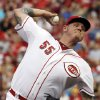 Photo - Cincinnati Reds starting pitcher Mat Latos throws against the Oakland Athletics in the first inning of a baseball game, Tuesday, Aug. 6, 2013, in Cincinnati. (AP Photo/Al Behrman)