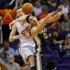 Photo - Phoenix Suns center Miles Plumlee, left, knocks the ball away from Utah Jazz center Enes Kanter during the first half of an NBA basketball game Friday, Nov. 1, 2013, in Phoenix. (AP Photo/Matt York)