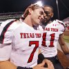 Texas Tech\'s Seth Doege (7) and Tramain Swindall (11) celebrate the 41-38 win over Oklahoma as they leave the field after the college football game between the University of Oklahoma Sooners (OU) and Texas Tech University Red Raiders (TTU) at the Gaylord Family-Oklahoma Memorial Stadium on Sunday, Oct. 23, 2011. in Norman, Okla. Photo by Chris Landsberger, The Oklahoman
