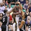 Photo -   San Antonio Spurs guard Stephen Jackson (3) and center Tim Duncan (21) double team Utah Jazz forward Paul Millsap (24) during the first half of Game 4 in the first-round NBA basketball playoff series, Monday, May 7, 2012, in Salt Lake City. (AP Photo/Colin E Braley)