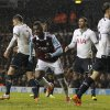 Photo - West Ham United's Modibo Maiga, center, celebrates his goal against Tottenham Hotspur during their English League Cup quarterfinal soccer match at White Hart Lane, London, Wednesday, Dec. 18, 2013. (AP Photo/Sang Tan)