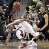 Photo - South Carolina's Tiffany Mitchell (25) looses control of the ball as she is fouled by Missouri's Bri Kulas (13) during the first half of their NCAA college basketball game Sunday Feb. 2, 2014, in Columbia, SC. (AP Photo/Mary Ann Chastain)