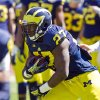 Photo - Michigan running back Derrick Green (27) takes a handoff and rushes during the NCAA college football team's annual spring game on Saturday, April 5, 2014, in Ann Arbor, Mich. (AP Photo/Tony Ding)