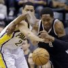 Brooklyn Nets guard MarShon Brooks , right is fouled by Indiana Pacers forward Gerald Green after making a steal in the first half of an NBA basketball game in Indianapolis, Monday, Feb. 11, 2013. (AP Photo/Michael Conroy)