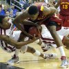 Oklahoma\'s Je\'lon Hornbeak (5) and Melvin Ejim (3) fight for a loose ball during the Phillips 66 Big 12 Men\'s basketball championship tournament game between the University of Oklahoma and Iowa State at the Sprint Center in Kansas City, Thursday, March 14, 2013. Photo by Sarah Phipps, The Oklahoman