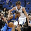 Orlando Magic\'s Arron Afflalo, left, drives around Minnesota Timberwolves\' Andrei Kirilenko, of Russia, during the first half of an NBA basketball game Wednesday, Nov. 7, 2012, in Minneapolis. (AP Photo/Jim Mone)