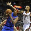 Detroit Pistons\' Charlie Villanueva left, drives to the basket against Milwaukee Bucks\' Drew Gooden (0) during the first half of an NBA basketball game on Saturday, Oct. 13, 2012, in Milwaukee. (AP Photo/Jim Prisching)