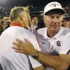 FILE - In this Sept. 10, 2011, file phot, South Carolina coach Steve Spurrier, right, and Georgia coach Mark Richt meet at midfield after the Gamecocks on 45-42 in an NCAA college football game in Athens, Ga. Coaches you\'d want on the sidelines of the biggest games? South Carolina\'s Steve Spurrier would have to be near the top of the very short list in college football. He gets the latest chance to enhance that reputation when the sixth-ranked Gamecocks take on No. 5 Georgia on Saturday. (AP Photo/John Amis, File)