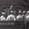 Photo - This image from an eight-second film clip provided by the National Archives shows President Franklin Delano Roosevelt, third from right, being pushed in a wheelchair aboard the U.S.S. Baltimore in Pearl Harbor in July 1944, depicting a secret not revealed to the public until after his death. (AP Photo/National Archives)