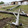 Snapped utility poles clutter the ground in front of Coates Roofing Co. on State Highway 99 in Seminole, Tuesday, May 11, 2010. Numerous homes and business, including the town\'s airport, were damaged in tornado that hit the community, located about 50 miles east of Oklahoma City, Monday night. Photo by Jim Beckel, The Oklahoman