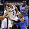 Oklahoma City\'s Russell Westbrook (0) and San Antonio\'s Tim Duncan (21) chase the ball near Oklahoma City\'s Kendrick Perkins (5) during Game 5 of the Western Conference Finals in the NBA playoffs between the Oklahoma City Thunder and the San Antonio Spurs at the AT&T Center in San Antonio, Thursday, May 29, 2014. Photo by Sarah Phipps, The Oklahoman