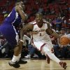 OU: Oklahoma\'s Sam Grooms drives the ball past Northwestern\'s Gary Roberson (34) during a men\'s college basketball game between the University of Oklahoma and Northwestern Louisiana State University at the Lloyd Noble Center in Norman, Okla., Friday, Nov. 30, 2012. Photo by Garett Fisbeck, The Oklahoman