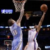 Oklahoma City\'s Russell Westbrook (0) goes to the basket between Denver\'s Chris Andersen (11) and Ty Lawson (3) during the NBA basketball game between the Denver Nuggets and the Oklahoma City Thunder in the first round of the NBA playoffs at the Oklahoma City Arena, Sunday, April 17, 2011. Photo by Bryan Terry, The Oklahoman