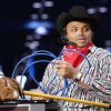 Photo - Charles Barkley, dressed in mock cowboy attire, waits on the set for the beginning of TNT's Inside the NBA at the NBA Jam Session, part of the NBA All-Star events in Houston, Texas, Febraury 16, 2006. Barkley was dressed up to address the negative comments he made about Oklahoma during a broadcast last week. By Nate Billings, The Oklahoman.