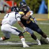 UCO\'s Joshua Birmingahm tries to get by Washburn\'s Devon Connors during the college football game between the University of Central Oklahoma and Washburn at Wantland Stadium in Edmond, Okla., Saturday, Sept. 22, 2012. Photo by Sarah Phipps, The Oklahoman