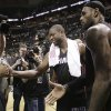 Miami Heat\'s Dwyane Wade, left, and LeBron James leave the floor after beating San Antonio Spurs at Game 4 of the NBA Finals basketball series, Thursday, June 13, 2013, in San Antonio. The Heat won 109-93. (AP Photo/Eric Gay)